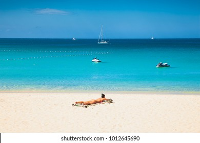 PUKET, THAILAND-JAN 24,2016: Unidentified girl are relaxing on Kata beach during a sunny day in Phuket on Jan 24, 2016, Thailand.