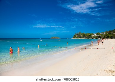 PUKET, THAILAND-JAN 24,2016: Unidentified people are relaxing on Kata beach during a sunny day in Phuket on Jan 24, 2016, Thailand.