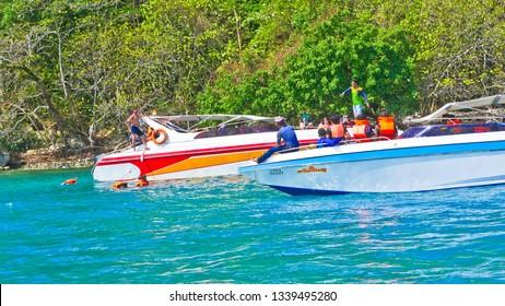 Puket,Thailand -  February 18 2019 : Mr Tanakrit Phromboot  traveling by speed boat  to Puket for summer and holiday   at Puket,Thailand.