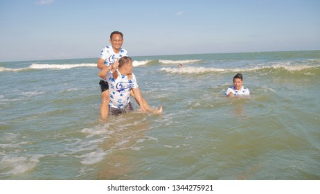 Puket,Thailand - March 13 2019 : Nonidentical people are playing in the sea for summer and holiday at Puket-,Thailand.