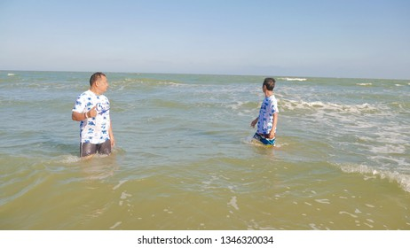 Puket,Thailand - March 13 2019 : Nonidentical people are playing in the sea for summer and holiday at Puket,Thailand.