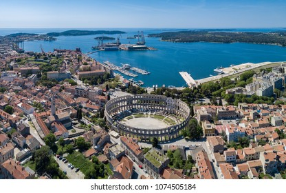 Pula aerial drone shot. The Arena is the only remaining Roman amphitheatre to have four side towers and with all three Roman architectural orders entirely preserved. It was constructed in 27 BC–68 AD
