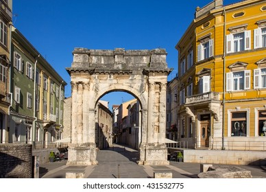 PULA, CROATIA - APRIL 30, 2016: The ??Golden Gate?� was erected between the years 29 and 27 BC.The adjacent street is a shopping area.