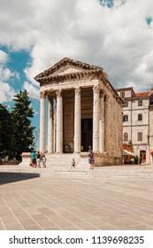 Pula, Croatia - August 29, 2013: Temple of Augustus at Forum square, Pula, Croatia