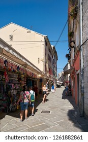 PULA, CROATIA – JULY 20, 2018: Tourists at a souvenir shop in the old town of Pula in Croatia