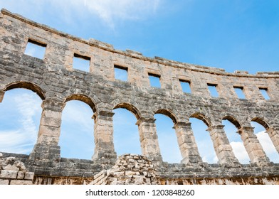 Pula, Croatia - June 18, 2014: Stone arc columns rows in Pula Arena. The most famous and important monument in Pula, popularly called the Arena of Pula, which was once the site of gladiator fights.
