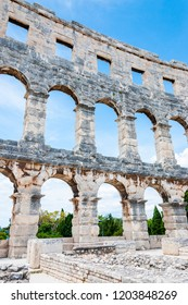 Pula, Croatia - June 18, 2014: Facade wall arc columns rows in Pula Arena. The most famous and important monument in Pula popularly called the Arena of Pula which was once the site of gladiator fights