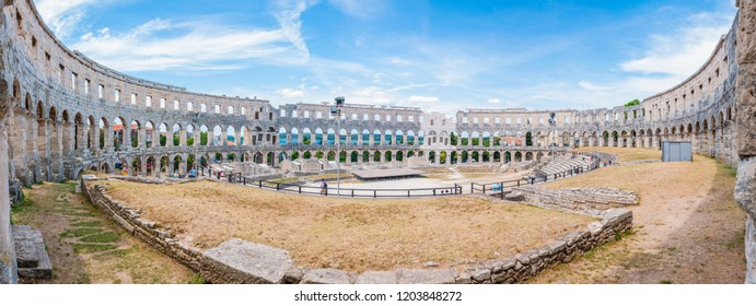 Pula, Croatia - June 18, 2014: Super wide angle inside panorama of Amphitheater or Pula Arena. The most famous and important monument in Pula, popularly called the Arena of Pula