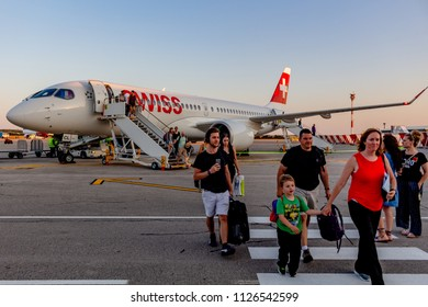 Pula, Croatia - June 30, 2018: Passengers desembarking the Swiss Airlines Bombardier CS300 arrived from Geneva at Pula Airport. Credit: Dino Geromella/Shutterstock