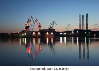 Pula, Croatia / - May 22nd 2017: Iluminated shipyard cranes in Uljanik, Pula, Croatia