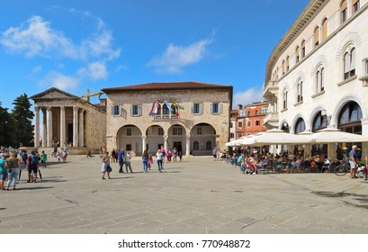 PULA, CROATIA - SEPTEMBER 1, 2017: The Forum square in Pula; The Forum square is a central square in Pula where main monuments like the Temple of Augustus and the Communal Palace are located.