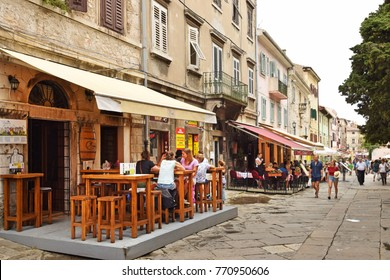 PULA, CROATIA - SEPTEMBER 1, 2017: Streetscape in Pula; Pedestrian street in Pula; the largest city in Istria; Croatia and popular tourist destination known for its Roman monuments.
