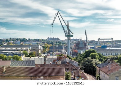PULA, CROATIA - SEPTEMBER 17: Shipyard and harbour in Pula bay on 17th September 2016 in Pula, Croatia.