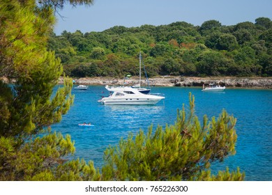 Pula, Croatia. Yacht in a bay against a background of green trees