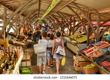 Pula, Istria, Croatia. August 2018. The fruit and vegetable market in Pula. It is outside the historic iron and glass structure. Among the stalls are also honey, oil and grappa of the highest quality.