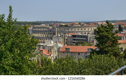 Pula, Istria, Croatia. August 2018. The Pula Arena by day. The point of view is exclusive: from the castle of Pula that surmounts the hill. The resemblance to the Colosseum in Rome is evident.