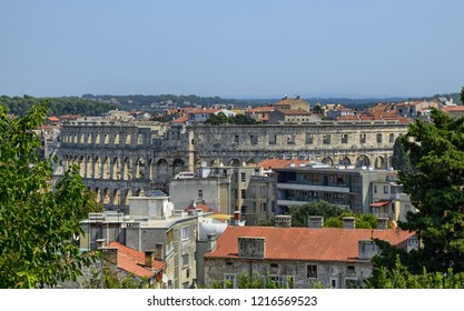 Pula, Istria, Croatia. August 2018. The Pula Arena by day. The point of view is exclusive: from the castle of Pula that surmounts the hill. The resemblance to the Colosseum in Rome is evident