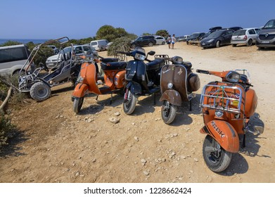 Pula, Istria, Croatia, August 2018. To the south of Pula, the Kamenjak nature park. Inside the park is the safari bar. A group of Vespa, from the Italian Piaggio, parked in front of the bar.