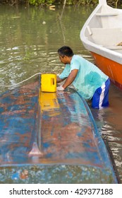 PULAU INDAH SELANGOR,MALAYSIA - 25/01/2016 - a fisherman was washing his boat for the new paint
