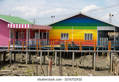 PULAU KETAM, MALAYSIA - 26 JUNE 2017 : A newly painted civilian home with concrete walkway at Crab island, a famous fishing village in Malaysia.