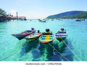 Pulau Perhentian, Malaysia CIRCA  2020 : Fishing bots on the with sky background