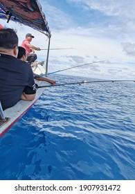 Pulau Redang, Terengganu - 2 July 2020: deep sea fishing on a boat at blue sea.