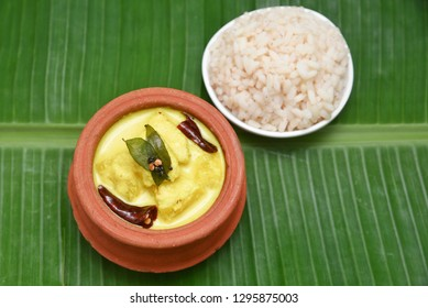 Pulissery or Moru curry is a popular authentic Kerala recipe made with buttermilk and cucumber or ash gourd. Hot and spicy curd curry a traditional South Indian cuisine for Onam, Vishu festival feast.