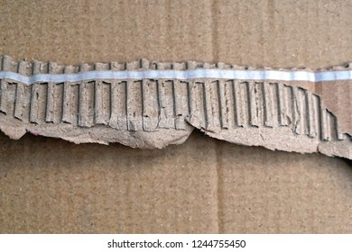 Pull to open strip at cardboard box