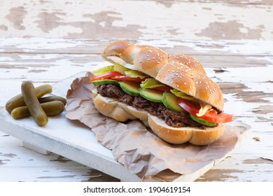 Pulled Beef Challah Sandwich With Lettuce, Cucumbers, Tomatoes, Red onion  and pickles