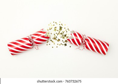 Pulled christmas cracker on a white background crackers