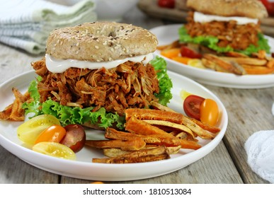 Pulled Jackfruit on Bagel with sweet potato French fries & Tomatoes