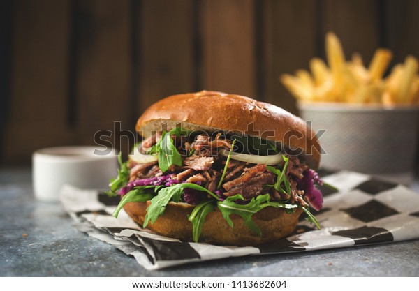 Pulled pork burger with french fries
