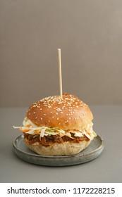 Pulled pork burger with homemade burger bun, pulled pork and coleslaw