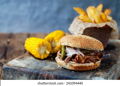 Pulled pork burger with sweet corn and chips