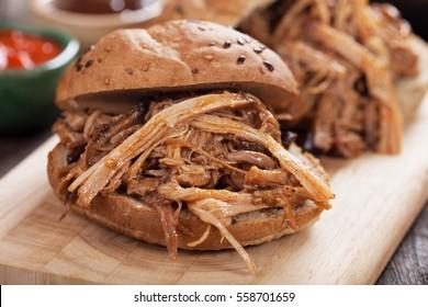 Pulled pork meat sandwich in whole grain burger bun