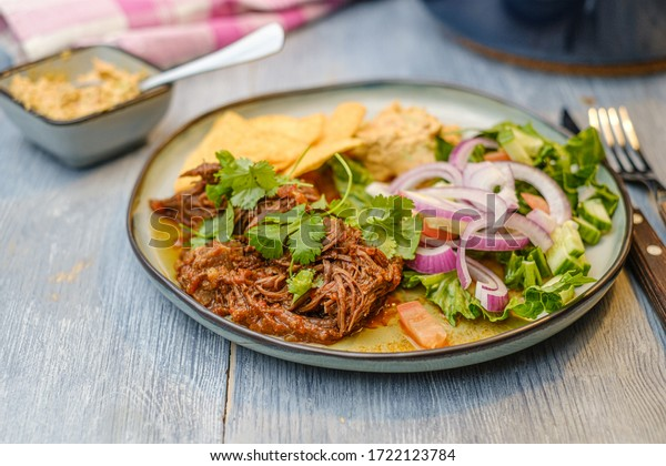 Pulled pork on a plate with traditional assessors