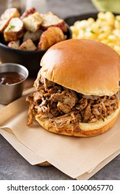 Pulled pork sandwich with bbq sauce on the table