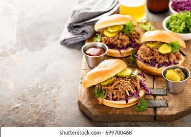 Pulled pork sandwiches with BBQ sauce, cabbage and pickles