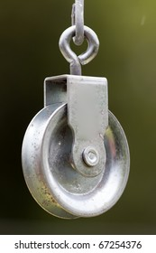 a pulley hanging on the wire garden