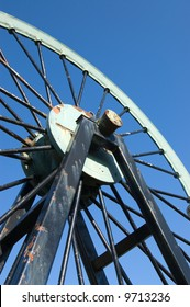 Pulley wheel from a coal mine against at blue sky