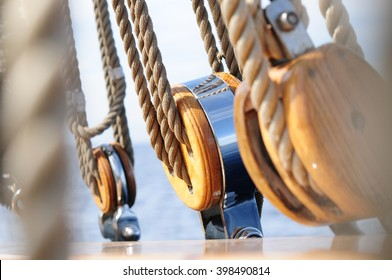 Pulleys with ropes in classic boat rail.