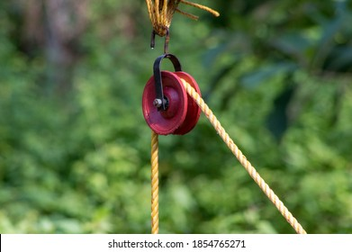 Pulleys are simple machines consisting of a wheel over which a pulled rope runs to change the direction of the pull used for lifting a load or water from well