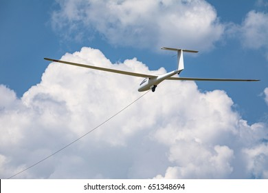 Pulling of a glider, a small sports plane pulls a glider into the cloud