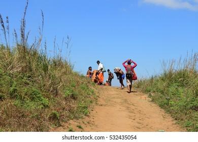 PULLUMEDU, INDIA - JAN 07 : Unidentified pilgrims walk through mountain path towards Sabarimala temple on January 07, 2012 in Pullumedu, Kerala, India. Around 50 million visit Sabarimala every season