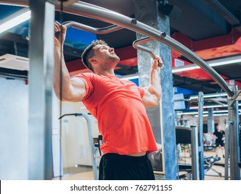 Pull-ups hard training gym man sport concept. Lifestyle of athlete. Strength of will.