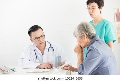 pulmonary function test, asian doctor sctreening old female, elderly health check up
