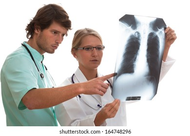 Pulmonologist and general surgeon watching x-ray scan before surgery