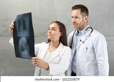 Pulmonologist, medical consultation Doctors are looking at the patient's x-ray picture.