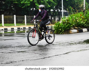Pulo Mas Jakarta, Indonesia - February 15 2021: A group of people pumping adrenaline by racing bicycles on the highway.