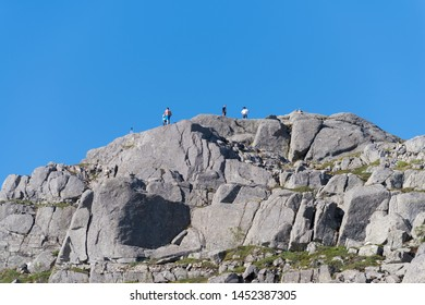 PULPIT ROCK, NORWAY - JULY 26, 2018: Unknown tourists looking down on Pulpit Rock. The Pulpit Rock or Preacher's Chair is a tourist attraction in the municipality of Forsand in Rogaland county